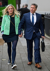 © Licensed to London News Pictures. 14/12/2015. London, UK. Radio DJ NEIL FOX, aka Dr Fox, arrives at Westminster Magistrates Court in London with his wife VICKY FOX, where a verdict is to be delivered on 10 separate charges against NEIL FOX of indecent assault and sexual assaul. Photo credit: Ben Cawthra/LNP