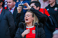 A Welsh supporter gets emotional during the National anthem during the UEFA European 2020 Qualifier match between Wales and Slovakia at the Cardiff City Stadium, Cardiff, Wales on 24 March 2019.