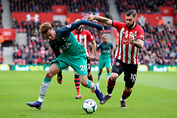 Tottenham Hotspur's Dele Alli (left) and Southampton's Charlie Austin battle for the ball during the Premier League match at St Mary's Stadium, Southampton.