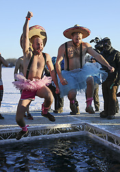 January 1, 2018 - Excelsior, MN, USA - Hundreds braved the sub zero temperatures on  New Years Day morning to take a frigid leap into the icy waters of Lake Minnetonka. It was the annual ALARC ICE DIVE at the Port of Excelsior dock, to help raise money for US veterans. Here, Josh Halloran of Blaine and Abe Dicks or Brooklyn Park, took a leap of faith into the new year dressed in their finest Tutu's and sombreros. ..BRIAN PETERSON Â¥ brian.peterson@startribune.com..Excelsior, MN  01/01/2018. (Credit Image: © Brian Peterson/Minneapolis Star Tribune via ZUMA Wire)
