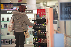 © Licensed to London News Pictures. 02/12/2020. <br /> Gravesend, UK. A shopper at Debenhams in Gravesend, Kent as lockdown ends and Kent move into tier three. Debenhams has lost JD Sports as a buyer and is going into administration. The high street giant has opened its doors today to begin a fire sale before all 124 UK stores close. Photo credit:Grant Falvey/LNP