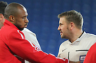 Cardiff City caretaker player manager Danny Gabbidon shakes hands with opposition players before the match. Capital One Cup, 3rd round match, Cardiff City v AFC Bournemouth at the Cardiff City stadium in Cardiff, South Wales on Tuesday 23rd Sept 2014<br /> pic by Mark Hawkins, Andrew Orchard sports photography.