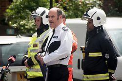 June 16, 2017 - London, United Kingdom - London Police Commander Stuart Cundy makes a statement to the media outside what remains of 24-storey Grenfell Tower Block which was gutted by fire, London on June 16, 2017. The toll from the Grenfell Tower block fire has risen to at least 30 people dead and the flames have now been extinguished, Metropolitan Police said. (Credit Image: © Alberto Pezzali/NurPhoto via ZUMA Press)