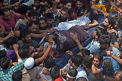 August 5, 2017 - India - (EDITORS NOTE: Image depicts death.) Uncle of Abid Hamid Mir, a militant of Lashkar-e-Toiba militant outfit clings on his corpse during his funeral procession in Mir Mohalla, Hajin in north Kashmir's Bandipora some 35 kilometers from Srinagar the summer capital of Indian controlled Kashmir on August 05, 2017. Thousands attended the funeral of Abid after he was killed along with two other militants in a gun battle with government forces in Amargarh area of Sopore north of Kashmir .With the killing of these three militants the total casualities from July have reached to fifteen. (Credit Image: © Faisal Khan/Pacific Press via ZUMA Wire)