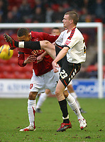 Photo: Dave Linney.<br />Walsall v Barnet. Coca Cola League 2. 24/02/2007.<br />Walsall's Mark Wright(L) appears to get a boot in the face from  Barry Cogan.