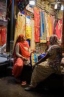 NEW DELHI, INDIA - CIRCA OCTOBER 2016: Women shopping for Sarees in the street market of Delhi Chandni Chowk area in Old Delhi.