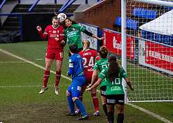 BIRKENHEAD, ENGLAND - Sunday, March 14, 2021: Liverpool's Meikayla Moore (L) challenges for a header with Coventry United's Destiney Toussaint during the FA Women's Championship game between Liverpool FC Women and Coventry United Ladies FC at Prenton Park. Liverpool won 5-0. (Pic by David Rawcliffe/Propaganda)