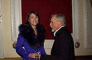Elizabeth Hurley and Dennis Hopper. Grand Classics Screening of 'Out of the Blue' hosted by Dennis Hopper. Electric cinema, Portobello Rd. London. 15 November 2004. ONE TIME USE ONLY - DO NOT ARCHIVE  © Copyright Photograph by Dafydd Jones 66 Stockwell Park Rd. London SW9 0DA Tel 020 7733 0108 www.dafjones.com