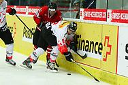 01.Mai 2012; Kloten; Eishockey - Schweiz - Kanada; Kevin Romy (R, SUI) gegen Andrew Ladd (L, CAN)<br />  (Thomas Oswald)