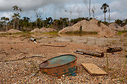 Deforested landscape, and waste in an old gold mining area in the mining corridor in the Peruvian Amazon. San Jose de Kareme, Peru.