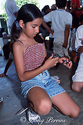 girl examines Kemp's ridley sea turtle hatchlings, Lepidochelys kempii, during educational program at turtle research camp, Rancho Nuevo, Mexico ( Gulf of Mexico )