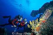 Butch Hendrick and Karen Van Hoesen <br /> inspect old anchor, St. Kitts, <br /> ( Eastern Caribbean Sea ) MR 134, MR 135