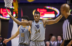 Jan 14, 2020; Morgantown, West Virginia, USA; West Virginia Mountaineers forward Oscar Tshiebwe (34) reacts to the fans during the second half against the TCU Horned Frogs at WVU Coliseum. Mandatory Credit: Ben Queen-USA TODAY Sports