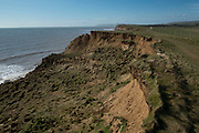 Coastal soil erosion on the south side of the Isle of Wight, United Kingdom. This eroded landscape is fast approaching the coast road which links the east of the island with the west. There is currently no provision or plan to sure up the area or move the road.