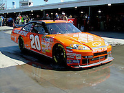 Tony Stewart rolls through the garage for practice on Pole Day of the Goody's Cool Orange 500 at Martinsville Speedway