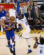 Golden State Warriors forward Draymond Green (23) defends New York Knicks forward Michael Beasley (8) at Oracle Arena in Oakland, Calif., on May 2, 2017. (Stan Olszewski/Special to S.F. Examiner)