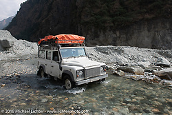 A Land Rover navigates a water crossing on Day-7 of our Himalayan Heroes adventure riding from Tatopani to Pokhara, Nepal. Monday, November 12, 2018. Photography ©2018 Michael Lichter.