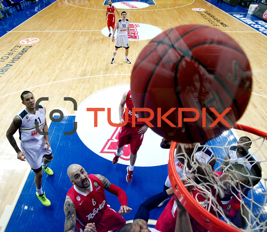 Olympiacos's Kyle Hines (R), Pero Antic (2ndL) during their Euroleague Basketball Top 16 Game 13 match Fenerbahce Ulker between Olympiacos at Fenerbahce Ulker Sports Aren in Istanbul, Turkey, Thursday, March 29, 2013. Photo by TURKPIX