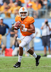 Sep 1, 2018; Charlotte, NC, USA; Tennessee Volunteers quarterback Jarrett Guarantano (2) rolls out of the pocket during the first quarter against the West Virginia Mountaineers at Bank of America Stadium. Mandatory Credit: Ben Queen-USA TODAY Sports
