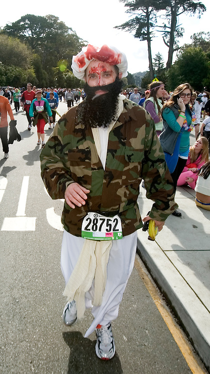 In keeping with the practice of topical costumes, David Sullivan of Campbell, Calif. walks through Golden Gate Park dressed as the late Osama Bin Laden, during the 100th running of the Bay to Breakers 12K in San Francisco, Sunday, May 15, 2011. (Photo by D. Ross Cameron)