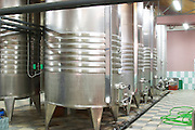 Stainless steel fermentation and storage tanks with cooling coils on the outside. Kantina Miqesia or Medaur winery, Koplik. Albania, Balkan, Europe.