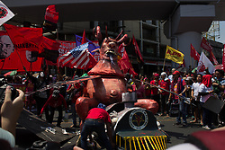 May 1, 2019 - Manila, Philippines - Protesters prepare to burn an effigy depicting President Rodrigo Duterte as a demon during a rally near the Malacanang presidential palace in celebration of International Labor Day Wednesday, May 1, 2019. (Credit Image: © Richard James Mendoza/NurPhoto via ZUMA Press)