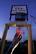 USA_SCI_UFO_28_xs<br /> UFO billboard. Alien hand and sign advertising UFO Space Storage in Roswell, USA. The town has many tourist attractions around the theme of UFO's. It was near Roswell on the evening of 2 July 1947 that many UFO sightings were reported during a thunderstorm. Next morning a rancher, Mac Brazel, discovered strange wreckage in a field. When the impact site was located, a UFO craft and alien bodies were allegedly found. On 8 July 1947, the Roswell Daily Record announced the capture of a flying saucer. The official explanation was that it was a crashed weather balloon. Many Roswell inhabitants, however, believe this a cover up, and Roswell has become a symbol for UFO enthusiasts. (1997)<br /> Photo illustration.