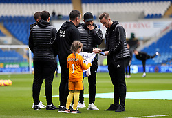 Leicester City's James Maddison signs a shirt for the match day mascot before the match