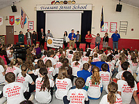 Principal Dave Levesque makes the announcement to his students as Pleasant Street School receives the New Hampshire Elementary School of the Year award on Friday morning.  (Karen Bobotas/for the Laconia Daily Sun)