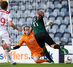 Falkirk's keeper Jamie MacDonald saves from Raith Rovers Martin Scott.<br /> Raith Rovers 0 v 0 Falkirk, Scottish Championship game played 27/9/2014 at Raith Rovers Stark Park.