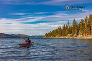 Sea kayaking on Flathead Lake at Wild Horse Island State Park, Montana, USA MR