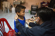 Jan 24, 2014 - Chiang Mai, Thailand - <br /> <br /> Nine Year Old Muay Thai Fighter<br /> <br /> Focus has a brief checkup before his fight at the Thapae Muay Thai Stadium in Chiang Mai. PETCHFOGUS SITTHAHARNAEK, 9, aka Focus is the top fighter for his age and weight in Chiang Mai. He has begun fighting older, heavier opponents to continue to improve his skills. Fighters are typically paid 1000 baht  per fight. <br /> ©Exclusivepix