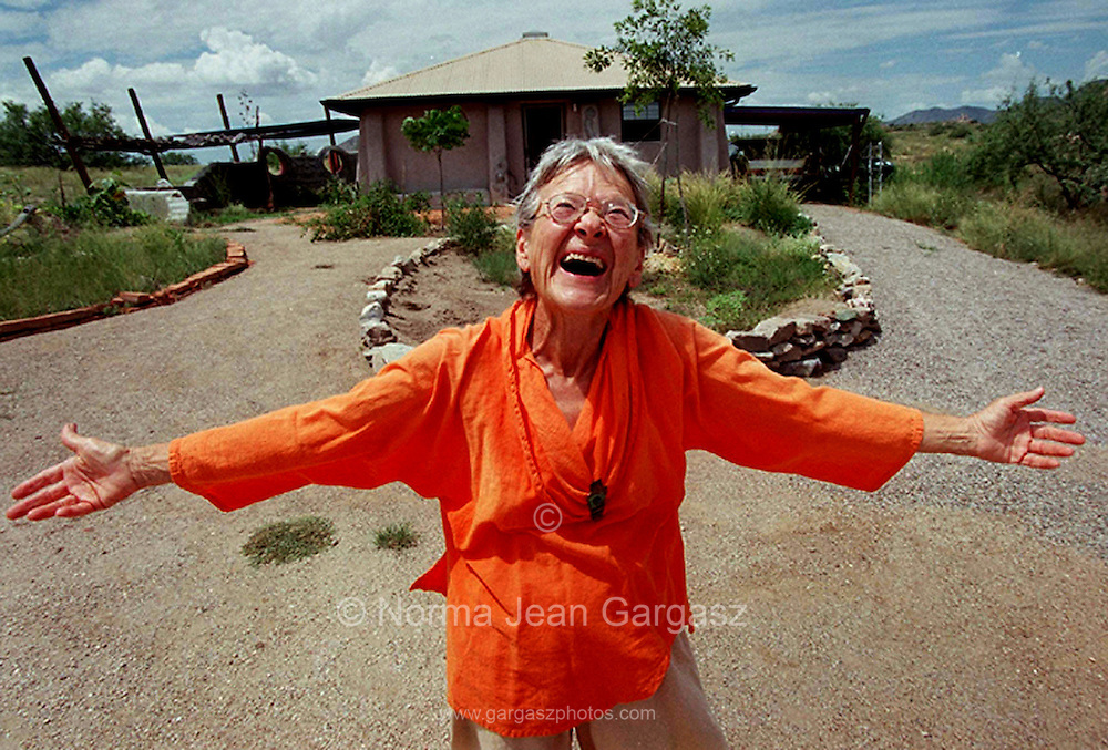 Allegra Ahlquist, 75, member of the Council of Grandmothers, whirls 33 times every morning in her front yard to activate her chakras.
