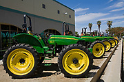 New Tractors lined up outside of a John Deere dealership, Oxnard, Ventura County, California, USA