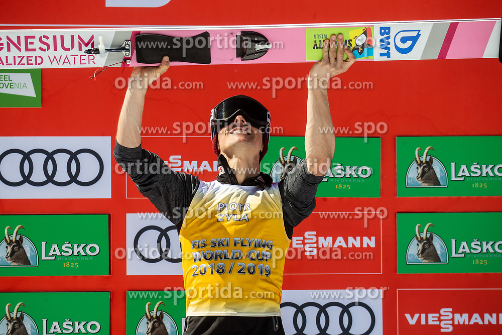 Piotr Zyla (POL) celebrates at trophy ceremony as third placed in FIS Ski Flying 2018/19 Classification after the Ski Flying Hill Individual Competition at Day 4 of FIS Ski Jumping World Cup Final 2019, on March 24, 2019 in Planica, Slovenia. Photo by Vid Ponikvar / Sportida