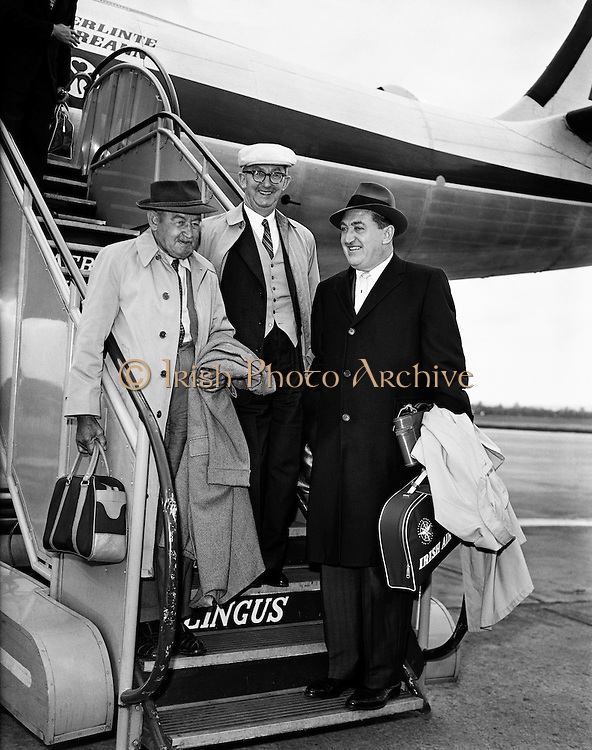 """Special for Aer Lingus - Arrival from new York of Barry Fitzgerald and J. J. O'Leary and Jack Feeney (John Ford).02/05/1959..Barry Fitzgerald (10 March 1888 - 14 January 1961) was an Irish stage, film, and television actor...J.J. O'Leary was Fitzgerald's best friend, the owner of a printing works...John Ford (February 1, 1894 - August 31, 1973) was an American film director. He was famous for both his westerns such as Stagecoach, The Searchers, and The Man Who Shot Liberty Valance, and adaptations of such classic 20th-century American novels as The Grapes of Wrath. His four Academy Awards for Best Director (1935, 1940, 1941, 1952) is a record, and one of those films, How Green Was My Valley, also won Best Picture..In a career that spanned more than 50 years, Ford directed more than 140 films (although nearly all of his silent films are now lost) and he is widely regarded as one of the most important and influential filmmakers of his generation. Ford's films and personality were held in high regard by his colleagues, with Ingmar Bergman and Orson Welles among those who have named him as one of the greatest directors of all time..In particular, Ford was a pioneer of location shooting and the long shot which frames his characters against a vast, harsh and rugged natural terrain..Ford was born John Martin """"Jack"""" Feeney (though he later often gave his given names as Sean Aloysius, sometimes with surname O'Feeny or O'Fearna; an Irish language equivalent of Feeney)."""