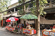 Street food vendors along a road in Suzhou, China.
