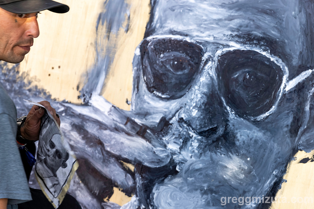 """Critter-Chris Alvarez's Artfort live painting  of Hunter S. Thompson"""" at LED in Boise, Idaho on September 27, 2021.<br /> <br /> Chris painted this portrait using his hands and fingers.<br /> <br /> Chris has been drawing most of his life and is a founding member of the art collective at Interfaith Sanctuary in Boise.<br /> <br /> He draws portraits and is a self-taught tattoo artist. Fine art and the technical aspects of drawing are what drive his creative work. He has always been interested in graffiti, and growing up in San Diego, that's what got him interested in being an artist. Graffiti was like looking at a maze with the colors and lines all over the place, and the block and bubble letters appear frequently in his work today.<br /> <br /> He draws and paints in a variety of mediums and recently completed a series of t-shirts commissioned to honor Donnie, an Interfaith Sanctuary guest who passed away in June."""