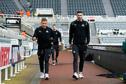 Dwight Gayle (#12) of Newcastle United and Fabian Schar (#5) of Newcastle United arrive ahead of the Premier League match between Newcastle United and Crystal Palace at St. James's Park, Newcastle, England on 21 December 2019.