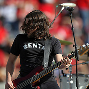 A member of the band for Grammy nominated country music star Dierks Bentley performs during halftime of the NCAA  Capital One Bowl football game between the Georgia Bulldogs and the Nebraska Cornhuskers, at the Florida Citrus Bowl on Tuesday, January 1, 2013 in Orlando, Florida. (AP Photo/Alex Menendez)