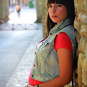 Spanish model striking a pose . My first photo shoot with natural light.