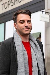 Adam Saban, 28, and Ausralian journalist, outside Topshop at Oxford Circus in London. London, October 26 2018.