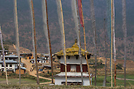 View of Sopsokha Village through Prayer Flags which are erected in Memoriam, Punakha District, Bhutan
