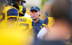 Sep 22, 2018; Morgantown, WV, USA; West Virginia Mountaineers head coach Dana Holgorsen talks to his team during the fourth quarter against the Kansas State Wildcats at Mountaineer Field at Milan Puskar Stadium. Mandatory Credit: Ben Queen-USA TODAY Sports
