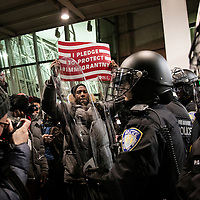 Police block the entrance to JFK Terminal 4 during a march against Trump's executive order banning citizens of 7 Muslim majority nations and refugees from entering the United States at JFK International Airport in New York City, NY on Saturday, January 28, 2017.