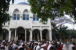 June 25, 2017 - Cibitung, West Java, Indonesia - Muslims perform an Eid prayer in Cibitung, Bekasi District, West Java, as they celebrate an Eid Al-Fitr holiday. All Muslims around the world celebrate an Eid Al-Fitr holiday after they perform fasting for a month in the holy Ramadan. (Credit Image: © Tubagus Aditya Irawan/Pacific Press via ZUMA Wire)