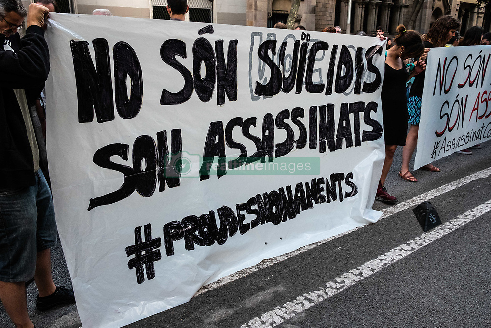 June 14, 2018 - Barcelona, Catalonia, Spain - A group of protesters are seen behind the main banner with the text ''They are not suicides, they are murders''. Some hundreds of people have concentrated before the Department of interior of the Generalitat de Catalunya, after the suicide of a man who was being evicted. The man has jumped into the void from his home on the tenth floor at the same moment that the judicial commission was trying to execute the eviction. (Credit Image: © Paco Freire/SOPA Images via ZUMA Wire)