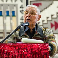 121213       Brian Leddy<br /> Former council delegate and Navajo Nation Speaker of the House Nelson Gorman speaks to Navajo Technical University students during commencement ceremonies Friday in Chinle.  The graduation was the first for the school as a university.
