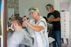 ©Licensed to London News Pictures 04/07/2020     <br /> Petts Wood, UK. Mr Snips hair studio and Barber shop in Petts Wood high street, Petts Wood, South East London, has reopened today after three months of coronavirus lockdown. Staff and customers have to wear PPE. Photo credit: Grant Falvey/LNP