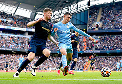 Burnley's Nathan Collins (left) and Manchester City's Phil Foden battle for the ball during the Premier League match at the Etihad Stadium, Manchester. Picture date: Saturday October 16, 2021.